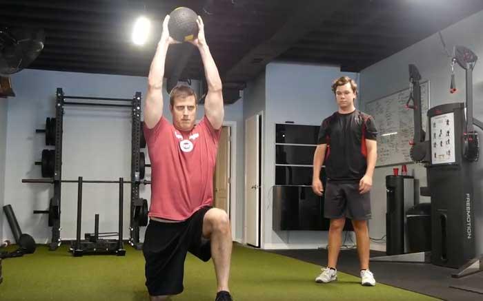 Half kneeling med ball slam