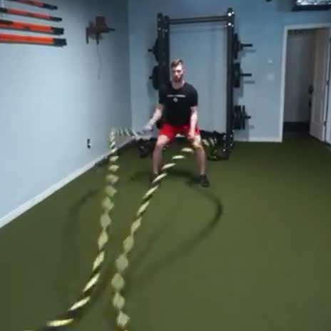 Man on battle rope training
