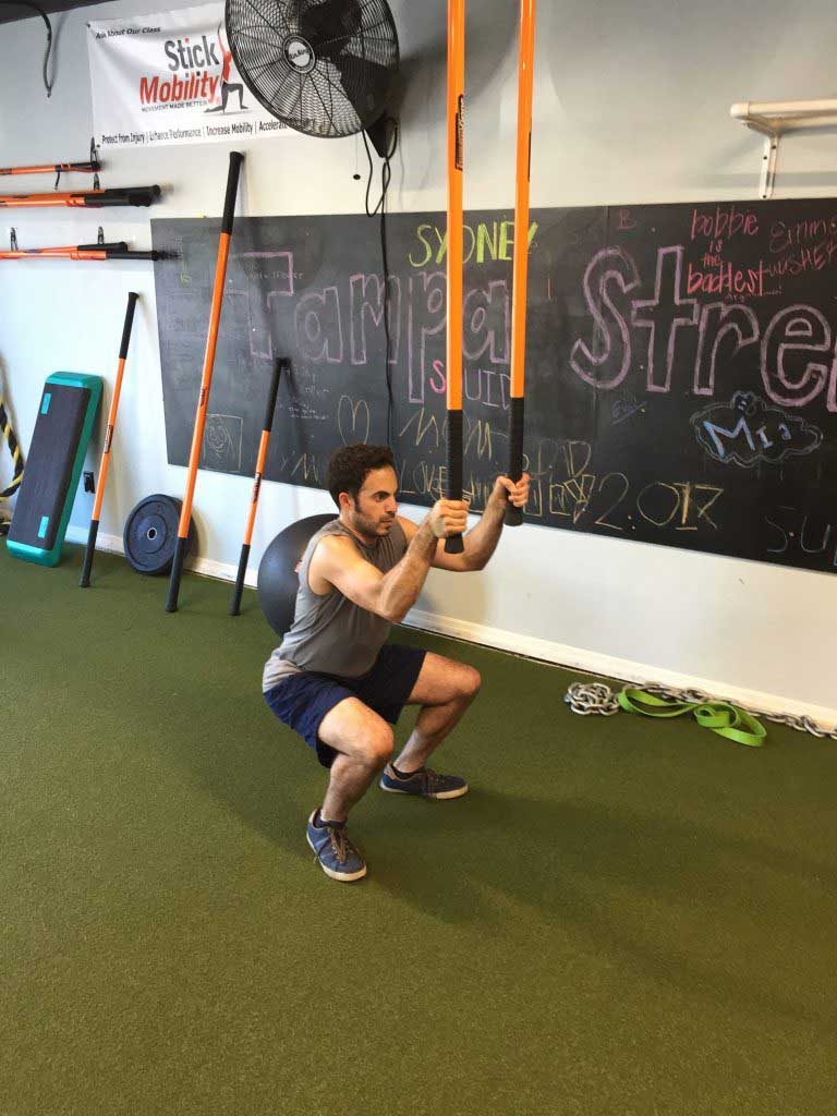 Man performs squat
